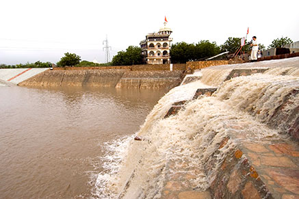 Water is accumulated during rain season in large surface water dam Om Ashram Rajasthan, India