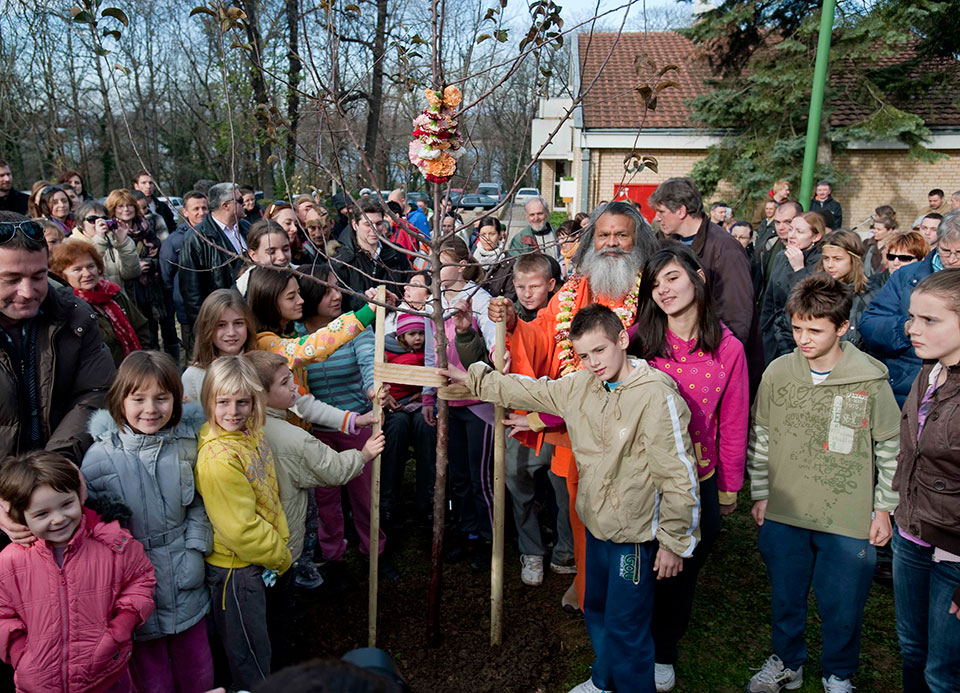 "His Holiness Vishwaguru Mahamandaleshwar Paramhans Swami Maheshwaranandaji planting World Peace Tree in ""Children Village"" in Novi Sad, Serbia"